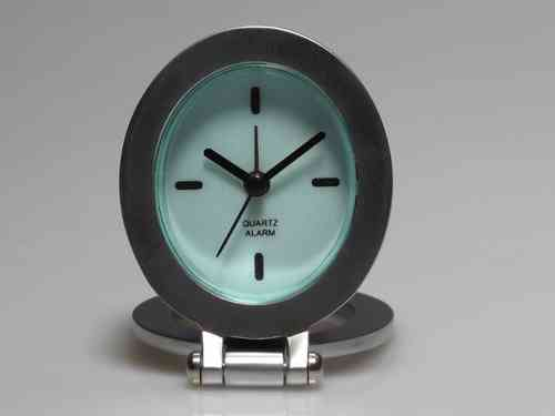 Desktop or travel clock with oval dial Quartz