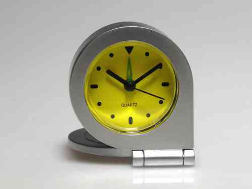 Travel clock with cover. Quartz and Yellow Dial