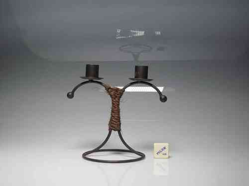 Double candlestick candle 18 cm. high. (PREOWNED)