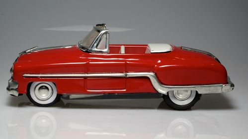 Old red convertible car, metallic tin approximately 1:18