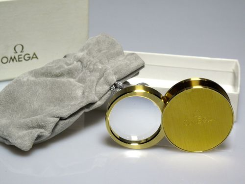 "R 335 Mini golden articulated magnifying glass ""OMEGA"" (see note)"